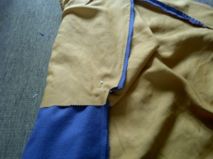 19.skirt parts right sides together, stitched, the seam pinked, ready to be pressed