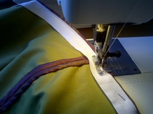 15.sewing the tape to the hem