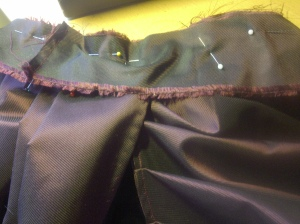 30.pinning the waistband, note the back piece overlaps the front -