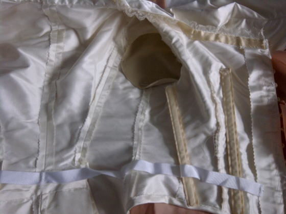11. inside the bodice, on the button side - there is one more bone under the seam allowance at the front edge. mark the sweat guard in the armhole.