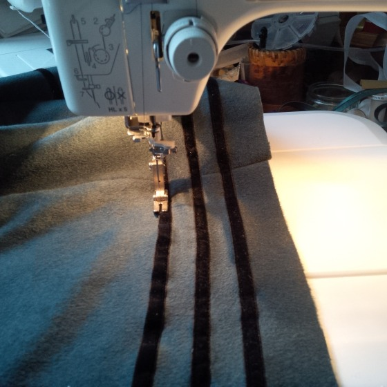 16. sewing the trim onto the back piece