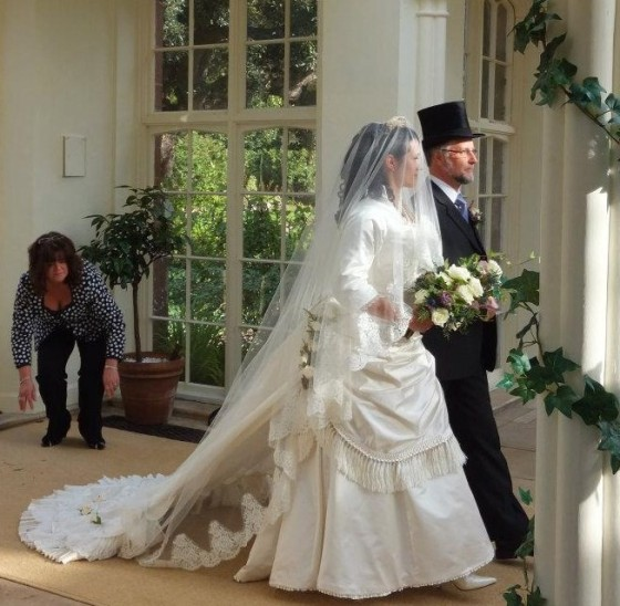 30. on the day - walking down the aisle, the lace on the veil showing nicely, bridging the gap  between the skirts and the train