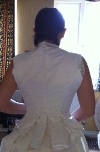 6. trying the bodice on - the back, showing the pleats pinned