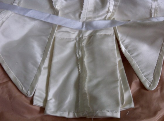 8. the back pleats - mark the bound edges , the tape and the bit covering the upper edges of the pleats