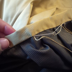 5.finishing the waistband, enclosing the raw edges of the pleated skirt